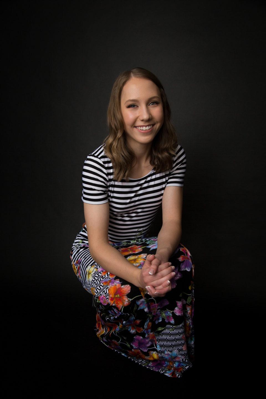 senior girl in striped flower dress